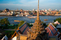 Bangkok. Landscape in sunset of Chao Praya River from Wat Arun Temple. Bangkok. Thailand. Asia. Wat Arun, locally known as Wat Chaeng, is situated on the west (Thonburi) bank of the Chao Phraya River. It is easily one of the most stunning temples in Bangkok, not only because of its riverside location, but also because the design is very different to the other temples you can visit in Bangkok. Wat Arun (or temple of the dawn) is partly made up of colourfully decorated spires and stands majestically over the water. Wat Arun is almost directly opposite Wat Pho, so it is very easy to get to.
