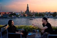 Bangkok. Couple of lovers. Landscape in sunset of Wat Arun Temple from Chao Praya River from the roof of Sala Rattanakosin Hotel. Bangkok. Thailand. Asia. Sala Rattanakosin restaurant and bar, sala rattanakosin's restaurant, is a scenic, riverfront dining option, overlooking the legendary chao phraya river and the mystical temple of dawn. Sala Rattanakosin bangkok also features the roof, this rooftop bar and terrace in bangkok provides idyllic riverfront setting to relax with a cold beverage at the end of a wonderful sightseeing day. At Sala Rattanakosin, we make sure that guests will have a memorable experience as they enjoy our wine bar and restaurant in bangkok. THE ROOF.