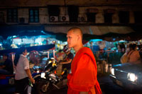 "Bangkok. Monk at night in Pak Khlong Talat , Flower market , Bangkok , Thailand. Pak Khlong Talat is a market in Bangkok, Thailand that sells flowers, fruits, and vegetables. It is the primary flower market in Bangkok and has been cited as a ""place[] of symbolic values"" to Bangkok residents. It is located on Chak Phet Road and adjacent side-streets, close to Memorial Bridge. Though the market is open 24 hours, it is busiest before dawn, when boats and trucks arrive with flowers from nearby provinces. The market has a long history. During the reign of Rama I (1782–1809), a floating market took place on the site of the modern Pak Khlong Talat; by the reign of Rama V (1868–1910), it had changed to a fish market. The fish market was eventually converted to today's produce market, which has existed for over 60 years."