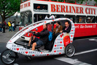 Turistic bus and Tourist Bicycle in Berlin, Germany. Berliner City Bus. If you decided to visit Berlin, a bike tour is the best way to get to know the city along with its beautiful sights and history.