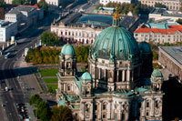 Berlin Cathedral, aerial landscape viewed from the TV tower, Berlin. The Berliner Dom (Berlin Cathedral), completed in 1905, is Berlin's largest and most important Protestant church as well as the sepulchre of the Prussian Hohenzollern dynasty. This outstanding high-renaissance baroque monument has linked the Hohenzollerns to German Protestantism for centuries and undergone renewed phases of architectural renovation since the Middle Ages. First built in 1465 as a parish church on the Spree River it was only finally completed in 1905 under the last German Kaiser -Wilhelm II. Damaged during the Second World War it remained closed during the GDR years and reopened after restoration in 1993.