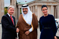 Berlin. Germany. Berlin Major Klaus Wowereit (C), accompanies the Emir of Qatar, Hamad bin Khalifa Al Thani (L), and his wife Mozah Binti Nasser Al Missned (R), to the landmark Brandenburg Gate in Berlin, Germany. Qatar celebrates its National Day in commemoration of the historic day in 1878 when Shaikh Jasim succeeded his father, Shaikh Muhammad Bin Thani, as a ruler and led the country towards unity. The event on December 18 is considered as an opportunity for all Qatari nationals and expatriates to recognise and celebrate what it means to live in modem day Qatar.