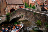 Sergi Reboredo. Bruges st bonifacius brigde. The St. Bonifacius Bridge is one of the many stone bridges over the canals on Brugge, Belgium. This bridge is close to the Gruuthuse and the Arentshof and although it is sometimes said to be the oldest bridge in Brugge that is not the case and was only built in around 1910. Around the bridge old medieval style houses can be seen adding to the atmosphere.