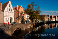 Bruges landscapes. Houses on Langerei street refelected in canal.