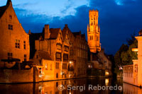 Bruges at night with the Belfry in the background, the most tipical landscape in Bruges. Evening view over Bruges : the Dijver canal and the Belfry tower.