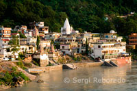 "Rishikesh also spelled Hrishikesh; Rushikesh; or Hrushikesh; is a city and a municipal board in Dehradun district in the Indian state of Uttarakhand.It is surrounded by two other districts namely Tehri Garhwal and Pauri Garhwal. It is located in the foothills of the Himalaya in northern India and attracts thousands of pilgrims and tourists each year; from within India; as well as from other countries. Rishikesh is a vegetarian city by law; as well as an alcohol-free city. Rishikesh has also banned use of plastics bags by shopkeepers and vendors. Rishikesh; sometimes nicknamed ""the world capital of Yoga""; has numerous yoga centres that also attract tourists. It is believed that meditation in Rishikesh brings one closer to attainment of moksha; as does a dip in the holy river that flows through it. Rishikesh is world famous for Rafting and Adventure. Rafting season starts from the month of March and ends in July. Rishikesh is also home to the 120-year old Kailas Ashram Brahmavidyapeetham; an institution dedicated to preserve and promote the traditional Vedantic Studies. Prominent personalities such as Swami Vivekananda; Swami Rama Tirtha and Swami Shivananda have studied in this institution. In February 1968; The Beatles visited the now-closed Maharishi Mahesh Yogi's ashram in Rishikesh.[6] John Lennon recorded a song titled; 'The Happy Rishikesh Song'.[7][8] The Beatles composed nearly 48 songs during their time at the Maharishi's ashram; many of which appear on the White Album. Several other artists visited the site to contemplate and meditate."