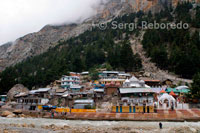 Gangotri; the source of the Ganga (Ganges) River and seat of the goddess Ganga; is one of the four sites in India's Char Dham pilgrimage. Gangotri can be reached in one day's travel from Rishikesh; Haridwar or Dehra Duhn; or in two days from Yamunotri. More popular and important than its sister site to the east; Gangotri is also accessible directly by car and bus; meaning that it sees many more pilgrims. A small village of guesthouses and restaurants serves the pilgrim community. Ritual duties are supervised by the Semwal family of pujaris. The aarti ceremony at the Gangotri is especially impressive; as is the temple; a stately affair that sits on the banks of the rushing Ganga (Ganges River). Adventurous pilgrims can make an overnight 17 km trek to Gaumukh; the actual source of the Ganga.