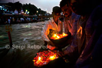 "Haridwar is famous for its Ganga Arati; worship of Ganga Maiya; held nightly at Har-ki-pari Ghat. Every night; (except for a short period during the summer when the ghat is cleaned & repaired; ) thousands of devotees & pilgrims gather about an hour before sunset. As the sky begins to darken; devotees bathe & offer diyas (leaf-boats with camphor flames) to the River. Chants are played over loudspeakers; such as Sri Hanuman Chalisa & others; as the spiritual energy continues to grow. Then; just as darkness descends; numerous priests; (I have counted as many as 16); come out from the ancient Ganga Mandir carrying huge flaming ghee lamps. It appears as though they are carrying campfires in their hands! The Ganga arati song is then played over the loudspeakers while all the thousands of pilgrims join in the singing & the priests wave their flaming lamps to Ma Ganga; swooping down to just skim the surface of the water: ""Om Jai Ganga Mata / Maiya Jai Gange Mata!"" The spiritual vibration & upliftment of consciousness one feels simply is beyond description. You will just have to go there & feel it for yourself! In just a few minutes the Arati is over & everyone dispersses -- until the next night. From Haridwar, Ganga enters the plains and his journey is somewhat quiet and agricultural. In this way part of the Ganges is diverted by a canal to its tributary Yamuna. Meanwhile flowing between majestic and artisan for 500 kilometers to Kanpur, a city of Uttar Pradesh plagued industries and businesses. Shortly after entering Kanpur victorious in the great city of Allahabad, refounded by the Mughal Emperor Akbar in 1583, although like most Hindus call it by its old name of Prayag. Some see this as the holiest site for coalesce around the Ganges, Yamuna and Saraswati, the invisible river that may have existed or not, or keep flowing underground as the faithful are deluded. The fact is that this confluence, called Triveni, mark the exact spot where bathing and for many is the best site that causes the release of continuous rebirth."
