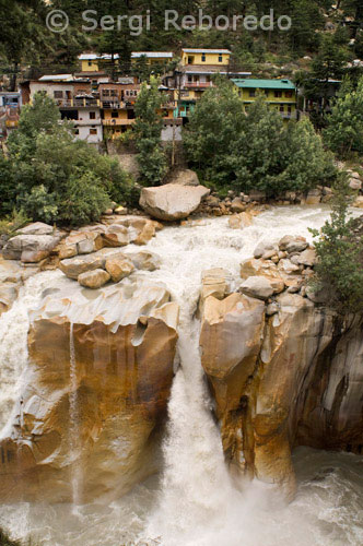 "INDIA CROSSING THE RIVER GANGES Gangotri is a very nice town and is fairly popular with foreigners; many who have come to make the trek to Gaumukh; or further. Unlike most of the other towns on the Char Dham route; it is a nice place to stay for a while. The Bhagirathi River rushes by and is extremely loud; giving the place a peaceful atmosphere. Gangotri is located about 250km from Rishikesh and 230km from Yamunotri. The bus trip via Tehri and Uttarkashi from Rishikesh takes 10 to 12 hours. At Gangotri the Kedar Ganga River merges with the Bhagirathi River at Dev Ghat; which is next to the main bridge; on the other side of the river from the temple. There is a falls called Sahasradhara about 100m below this confluence. Just before the falls the river squeezes itself into a narrow gorge about one metre wide. The actual source of the Ganges is Gaumukh; a hard 19km climb from Gangotri. Bhagiratha is said to have prayed at Gangotri to save his relatives. The Pandavas are said to have visited this place to atone for the sin of killing their relatives during the Kurukshetra war. At this point the Ganges River flows north; giving this village its name; Gangotri; which means ""Ganga turned north."" Lord Krishna says in Bhagavad-gita; Of flowing rivers I am the Ganges."
