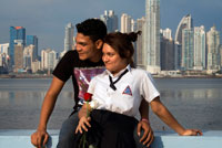 Two students lovers at Cinta Costera in Panama City. Skyline, Panama City, Panama, Central America. Cinta Costera Pacific Ocean Coastal Beltway Bahia de Panama linear park seawall skyline skyscraper modern. Coastal Beltway (Cinta Costera), Panama City, Panama. Panama City is one city in Central America where congestion has reached crisis point. The city is going through an unprecedented period of stability and investment and there are ample public funds for infrastructure improvement projects. One of the newest road improvement projects is the Coastal Beltway or Cinta Costera (translation means literally 'coastal tape') project. This project intends to decongest the road network of Panama City by providing a bypass route past the city.
