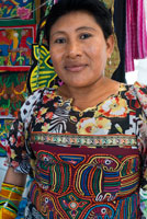 Portrait of Kuna women sell their molas to the tourists. Panama City Casco Viejo kuna indian traditional handicraft items sellers by kuna tribe.  Old Quarter, Panama City, Republic of Panama, Central America. In Balboa, on Avenida Arnulfo Arias Madrid and Amador, is a small YMCA Handicrafts Market, with mostly Kuna and Emberá indigenous arts and crafts, and clothing. Old Artesanal YMCA