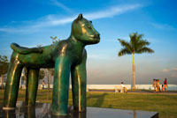 Sculpture of a panther at Green area in Cinta Costera Pacific Ocean Coastal Beltway Bahia de Panama linear park seawall skyline skyscraper modern. Coastal Beltway (Cinta Costera), Panama City, Panama. Panama City is one city in Central America where congestion has reached crisis point. The city is going through an unprecedented period of stability and investment and there are ample public funds for infrastructure improvement projects.
