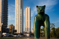 Sculpture of a panther at Green area in Cinta Costera Pacific Ocean Coastal Beltway Bahia de Panama linear park seawall skyline skyscraper modern. Coastal Beltway (Cinta Costera), Panama City, Panama. Panama City is one city in Central America where congestion has reached crisis point. The city is going through an unprecedented period of stability and investment and there are ample public funds for infrastructure improvement projects. One of the newest road improvement projects is the Coastal Beltway or Cinta Costera (translation means literally 'coastal tape') project. This project intends to decongest the road
