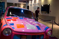 Pink car at lobby of HARD ROCK HOTEL PANAMA MEGAPOLIS. In the heart of Panama rises the new Hard Rock Hotel Panama Megapolis. This spectacular sixty-six story tower beckons you to come and experience where rock star service meets urban chic design – all infused with the passion and irreverence of rock 'n' roll. Located just a few miles from the Panama Canal, this Hard Rock Hotel puts you center stage with breathtaking panoramic views of the city and the Panama Bay.