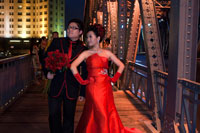 Wedding Photography at Garden bridge shanghai. Suzhou Creek, Waibaidu (Garden) Bridge, illuminated at night, Shanghai, China. The Waibaidu Bridge, Wàibáidù Qiáo, called the Garden Bridge in English, is the first all-steel bridge, and the only surviving example of a camelback truss bridge, in China. The fourth foreign bridge built at its location since 1856, in the downstream of the estuary of the Suzhou Creek, near its confluence with the Huangpu River, adjacent to the Bund in central Shanghai, connecting the Huangpu and Hongkou districts, the present bridge was opened on 20 January 1908. With its rich history and unique design the Waibaidu Bridge is one of the symbols of Shanghai.