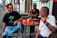 Three men take a delicious coffee in the central square of Filandia. Quindío. The ancient land of the Quimbayas opens to a geography of gently rolling hills, which are a permanent enjoyment for travelers who want coffee infinite landscapes. The architecture paisa of the population, with its balconies, its CASING contrasting colors, is one of its most beautiful features. The Spanish court's main square, is surrounded all the elements that make you feel is in the Coffee. The viewpoint of this town, festivals, friendly people, good coffee, are some of the reasons for good and go back to this wonderful town, it has had on several occasions the title of the most beautiful in Colombia.