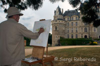 Jose Cavero Artiste Peintre Painting with paint the castle made into wine. Brissac Castle is the highest in France. Located strategically on the banks of the Maine and Loire short distance from hosting large numbers of religious orders who are missionaries all over the world.
